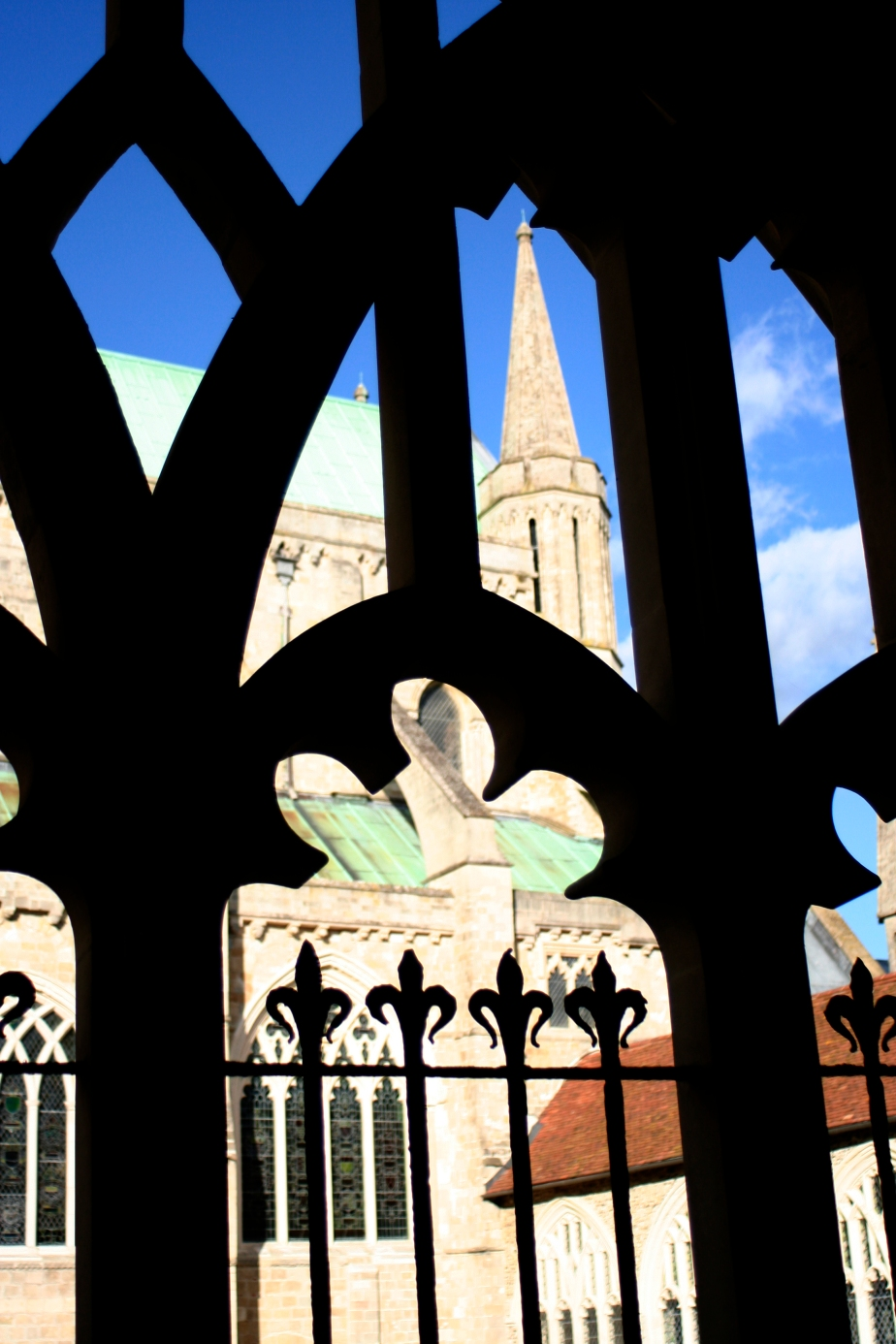 Chichester cathedral seen through cloister arches