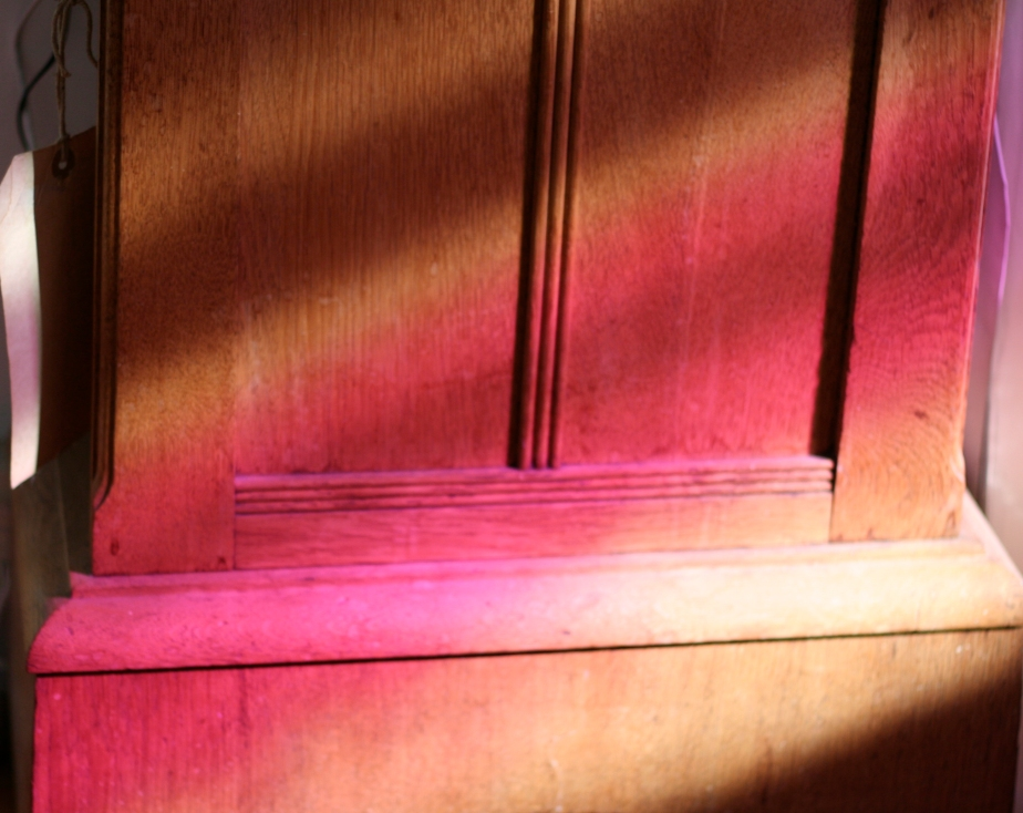 Pink light on oak clock