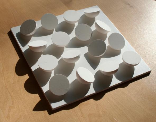 Shadows on geometric plaster cast sculpture