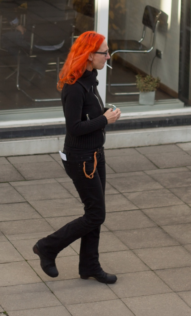 The reddest hair and the blackest clothes