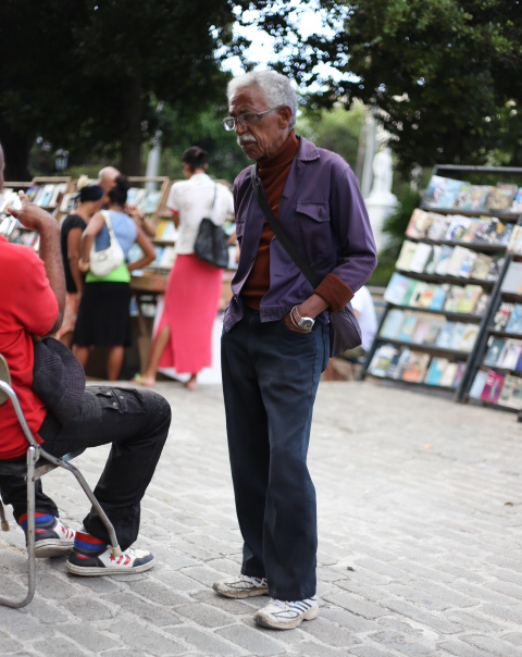 Cuban life is lived on the streets, everyone has a chair or a box to sit on.