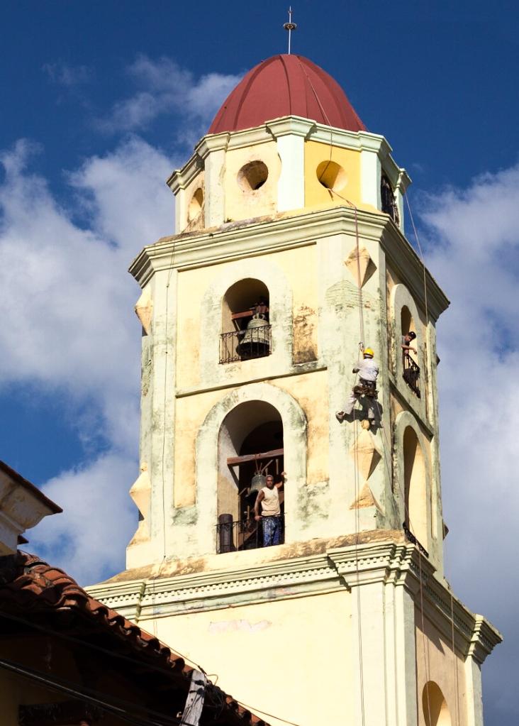 men in tower