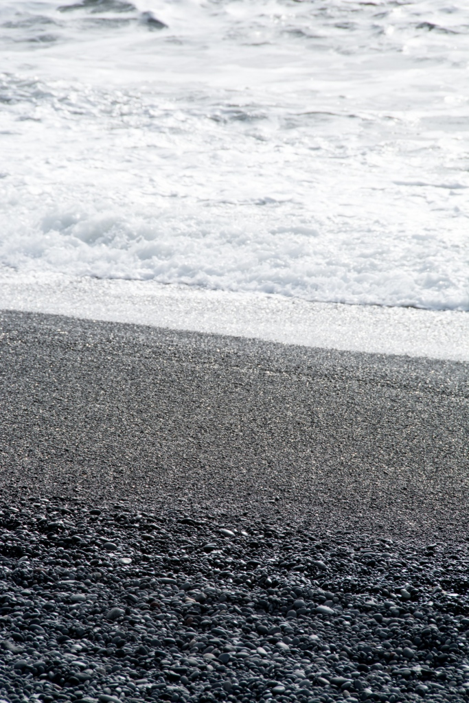 Black pebble beaches and white surf