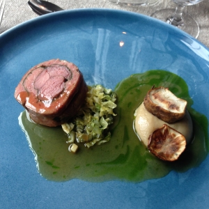 Baby goat with slow cooked jerusalem artichokes and lovage sauce