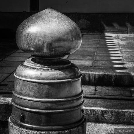 A copper bollard in a Shinto temple