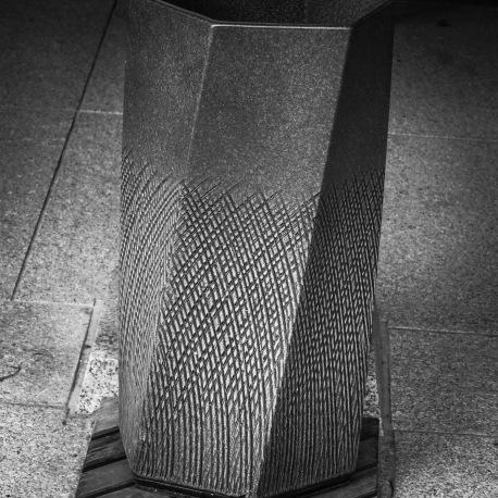 A concrete waste bin