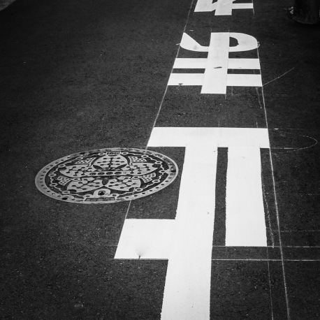 Marking out new road signs in Tokyo