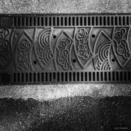 A metal drain cover.